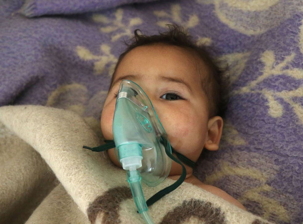 A Syrian child receives treatment following a suspected gas attack in Khan Sheikhoun, a rebel-held town in the northwestern Syrian Idlib province, on 4 April
