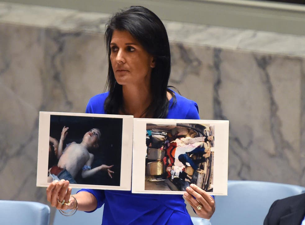 Nikki Haley, US ambassador to the UN, with photos of victims as she speaks during an emergency session at the UN on Wednesday
