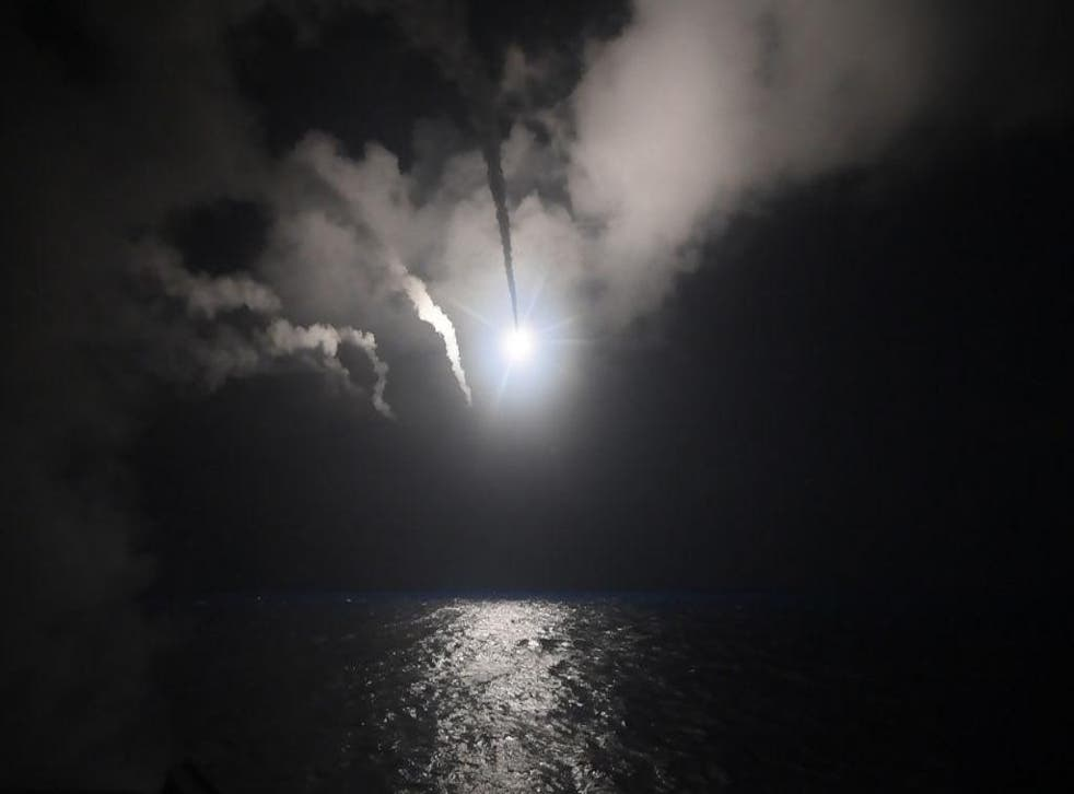 In this handout provided by the US Navy, the guided-missile destroyer USS Porter fires a Tomahawk land attack missile towards a Syrian government military position on April 7, 2017 from the Mediterranean Sea