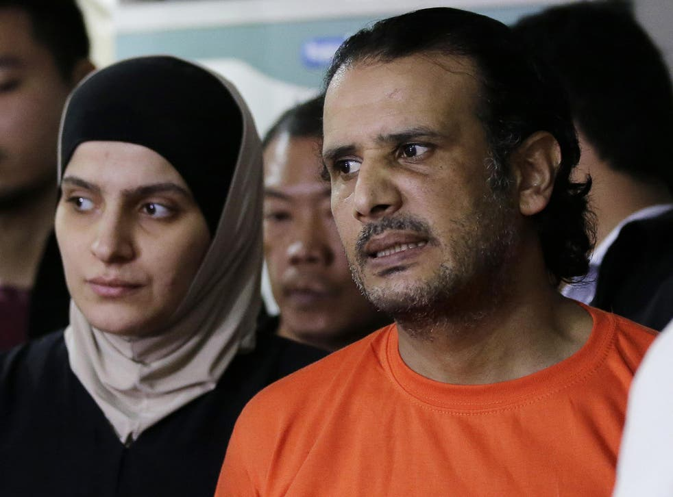 Suspected Isis members Rahaf Zina Dhafiri and Hussein Aldhafiri are presented to reporters at the National Bureau of Investigation in Manila