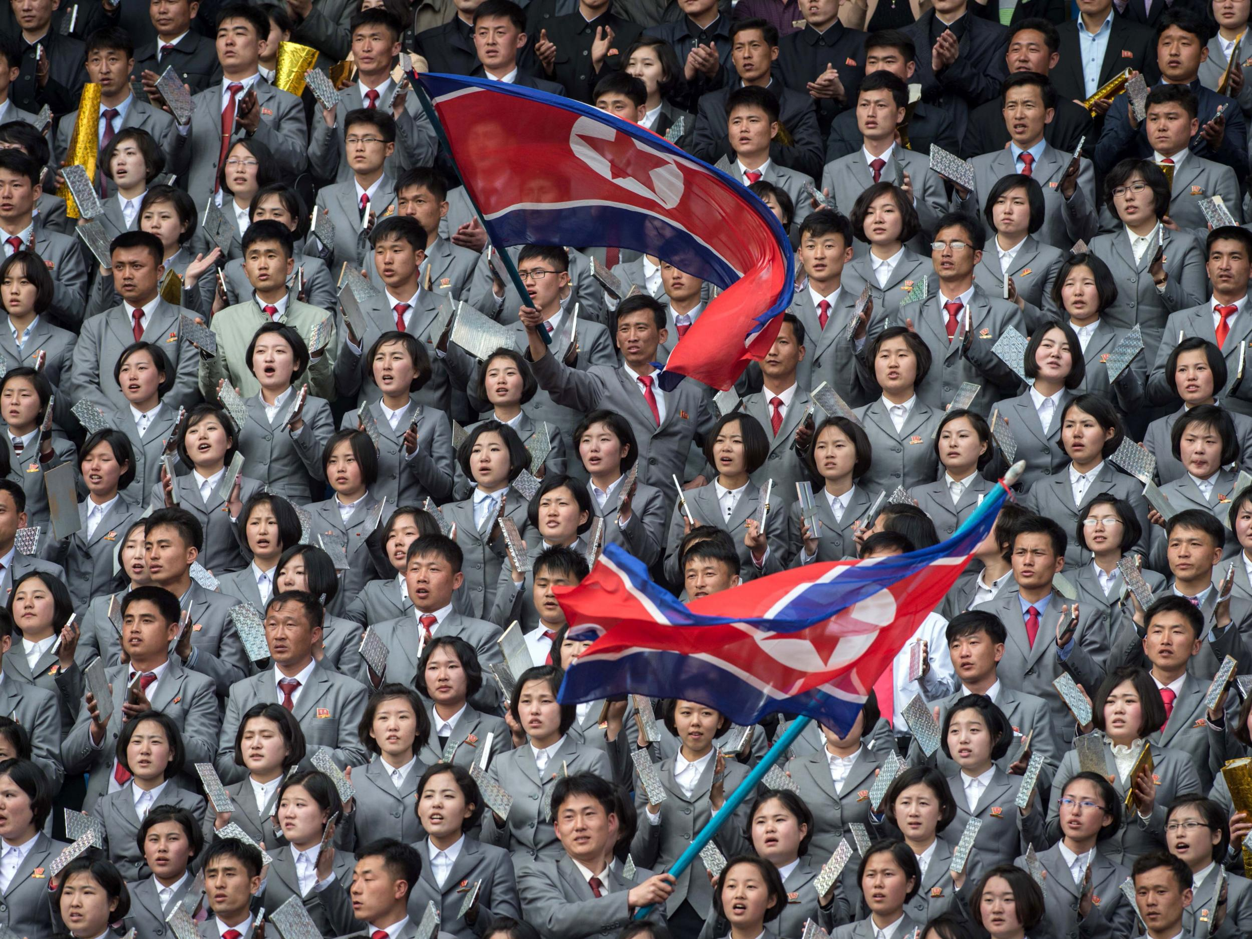 Political slogans, matching suits and briefcases: North Korea play the South in an international match like no other