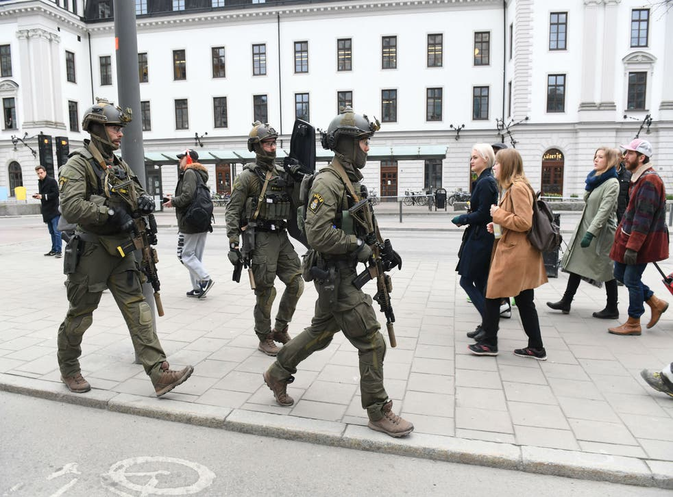Police patrolling outside Stockholm Central station yesterday