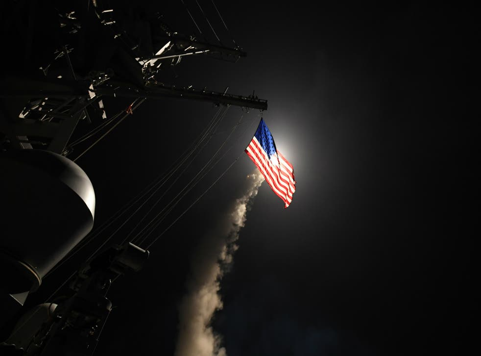 The guided-missile destroyer USS Porter fires a Tomahawk missile in the early hours of Friday