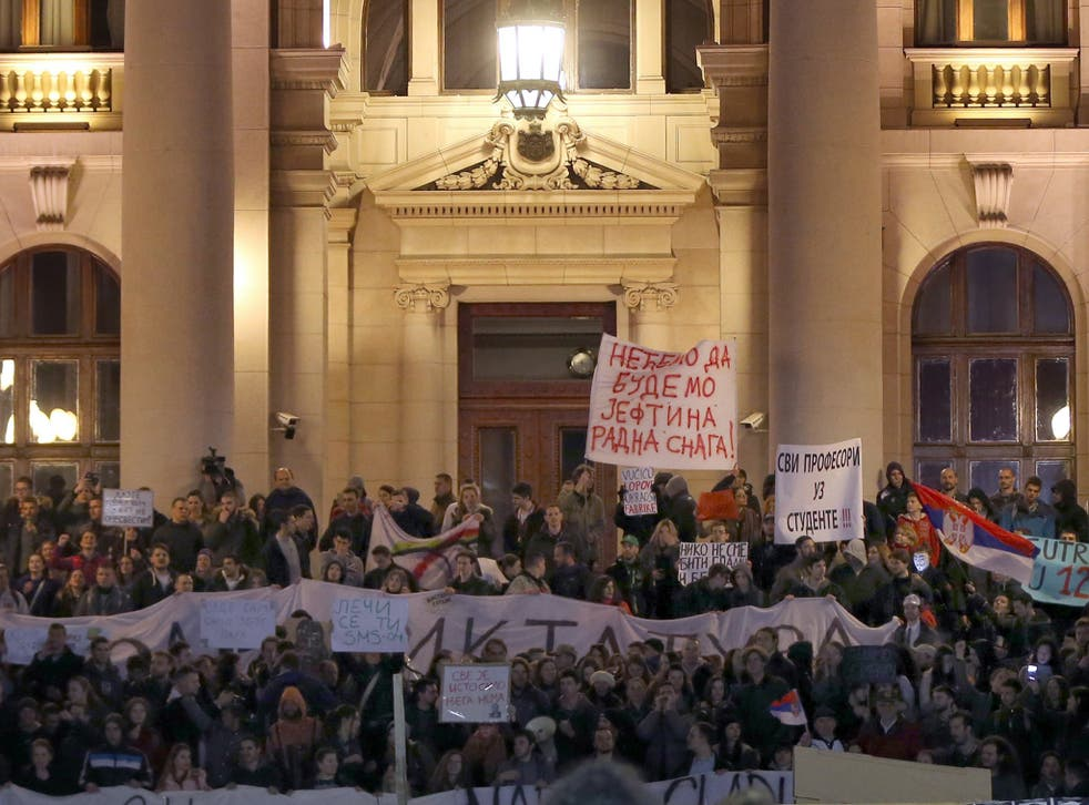 Protesters gather outside the National Assembly of Serbia on Friday denouncing the election victory of Aleksander Vučić