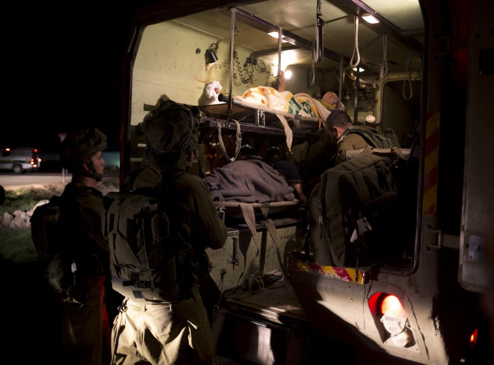 Israeli military medics assist wounded Syrians in Israeli controlled Golan Heights