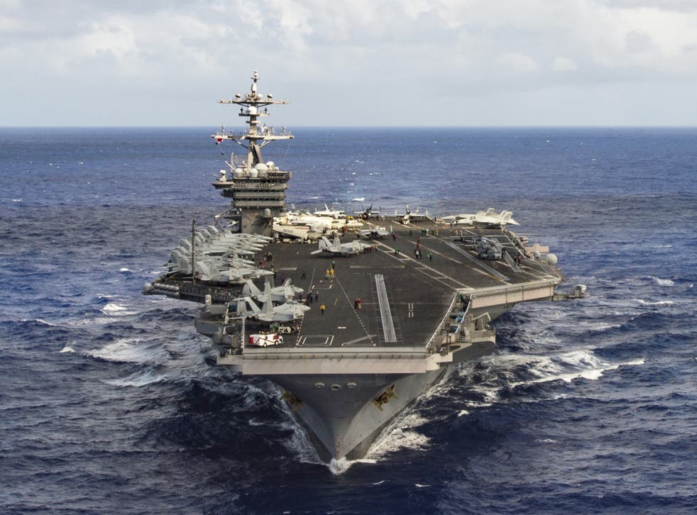 The aircraft carrier USS Carl Vinson transits the Pacific Ocean