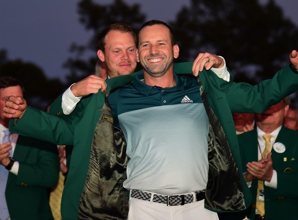 Danny Willett, last year's champion, awards Sergio Garcia with a green jacket