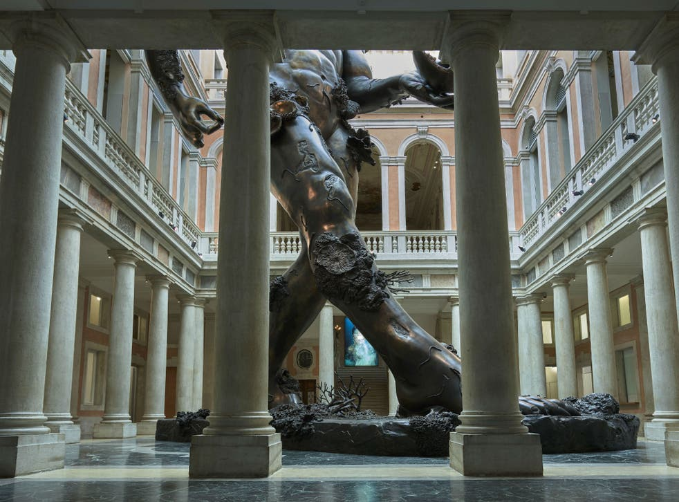 Damien Hirst's 'Demon with Bowl' In the large atrium of Venice's Palazzo Grassi