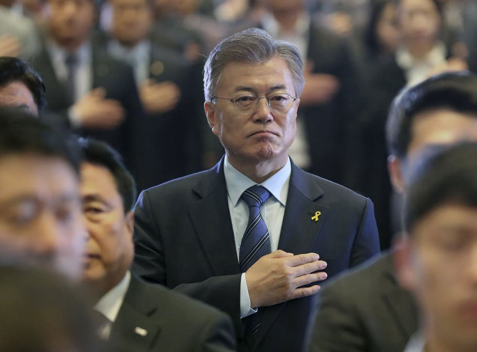 Heart and Seoul: Moon Jae-in, the presidential candidate of the Liberal Democratic Party of Korea, salutes the national flag