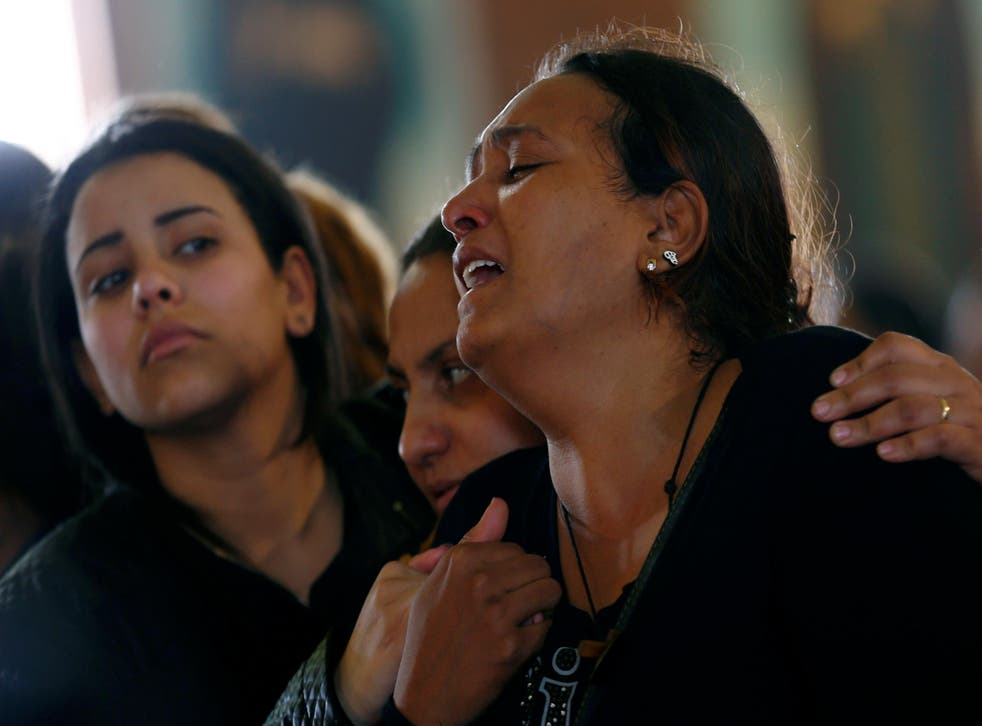 Relatives mourn for the victims of the Palm Sunday bombings during their funeral at the Monastery of Saint Mina in Alexandria, Egypt, on April 10, 2017