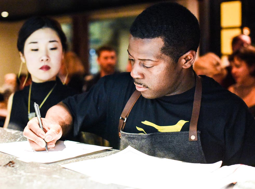 Junebaby's kitchen staff at work before the restaurant opens officially