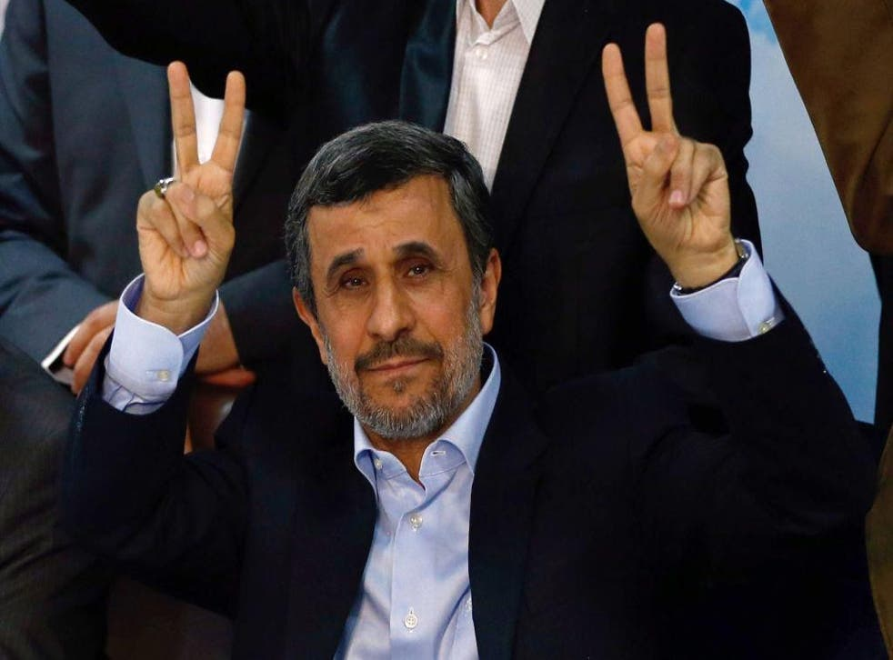 Mahmoud Ahmadinejad flashes the sign for victory at the Interior Ministry's election headquarters as candidates sign up for the upcoming presidential elections in Tehran on 12 April 2017