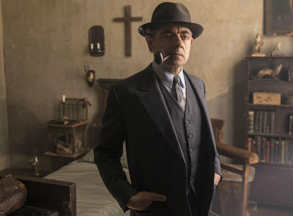 Rowan Atkinson playing the pipe-smoking French detective Maigret in ITV's 'Maigret's Night at the Crossroads'