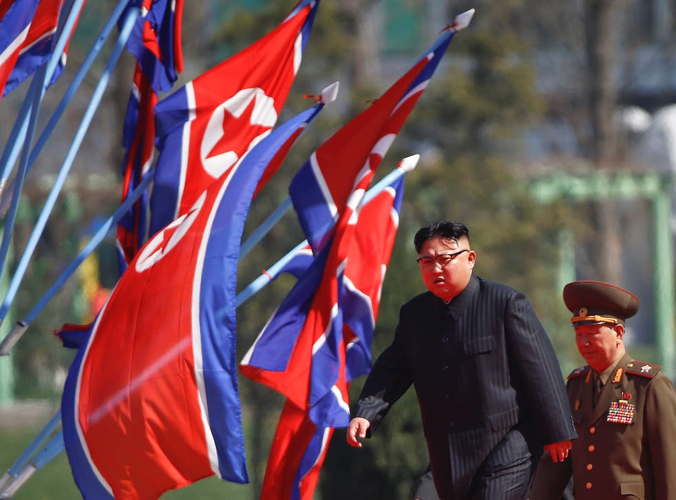 North Korean leader Kim Jong Un arrives for an opening ceremony of a newly constructed residential complex in Ryomyong street in Pyongyang, North Korea