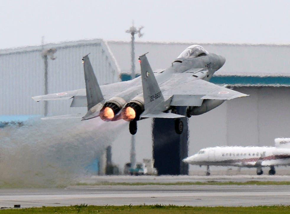 A Japanese Air Self Defence Force F-15 fighter scrambles at the Air Self Defense Force Naha base in Naha, Okinawa