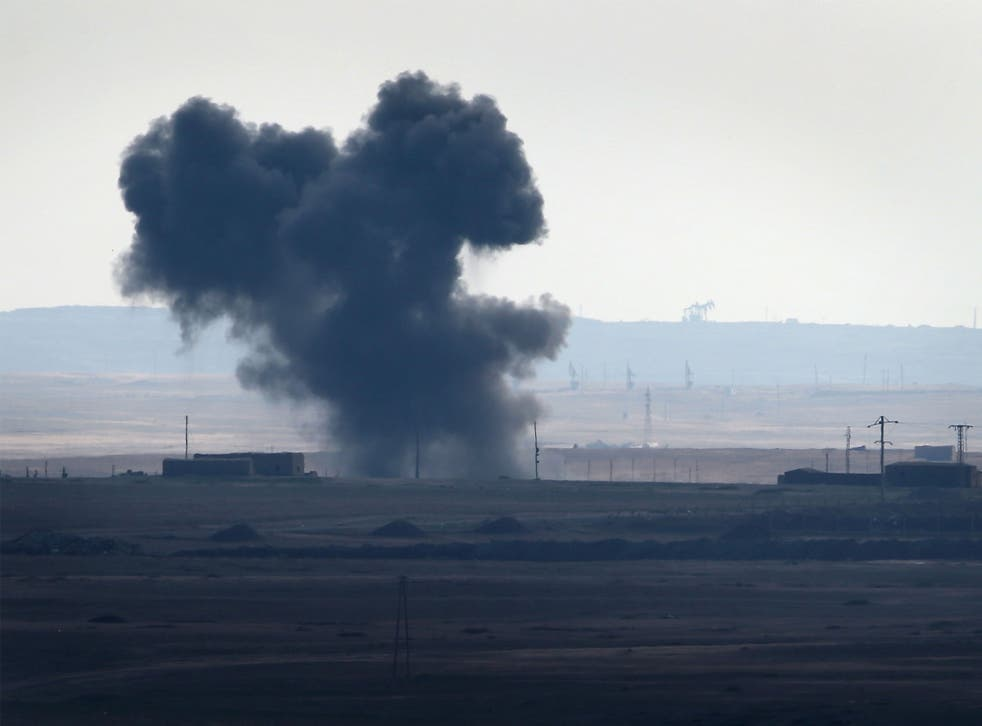 An air strike by a US-led coalition warplane explodes on an Isis position on November 10, 2015 near the town of Hole, Rojava, Syria