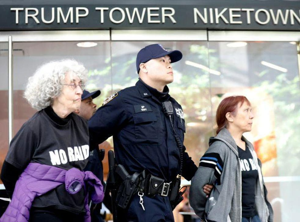 Protesters are led way from Trump Tower by police