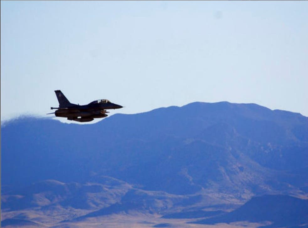 In this March, 2017, photo supplied by Sandia National Laboratories, an F-16C from Nellis Air Force Base in Nevada releases a mock nuclear weapon for a test at Tonopah Test Range near Tonopah, Nev. Scientists at Sandia National Laboratories are claiming success with the first in a new series of test flights that are part of an effort to upgrade one of the nuclear weapons that has been in the U.S. arsenal for decades