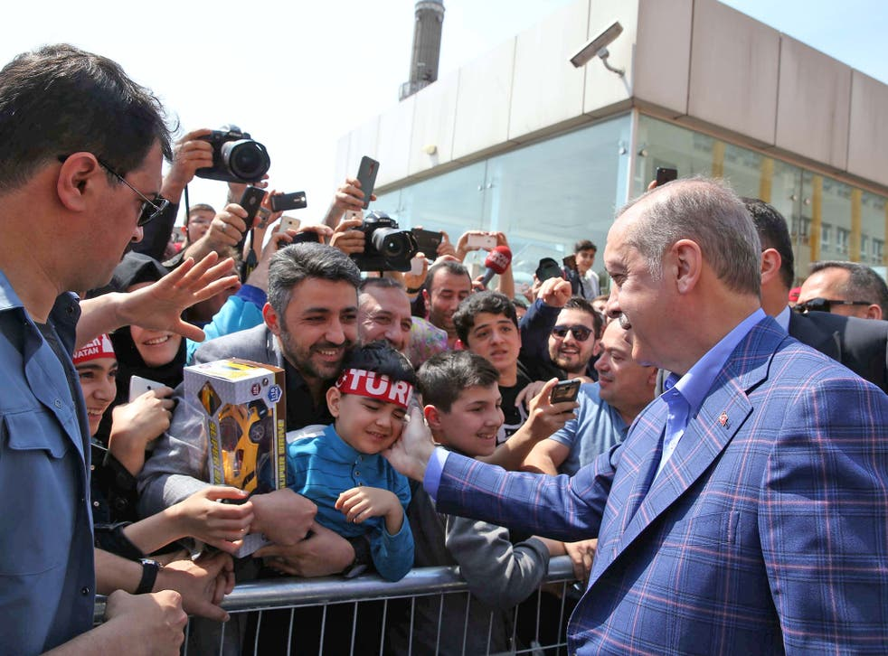 President Erdogan greets supporters outside a polling station. A 'yes' vote would make him immensely powerful