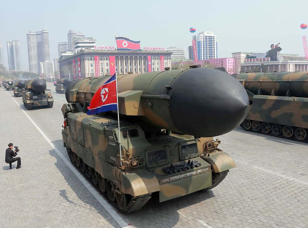 Korean People's Army ballistic missiles being displayed through Kim Il-Sung square during a military parade in Pyongyang marking the 105th anniversary of the birth of late North Korean leader Kim Il-Sung