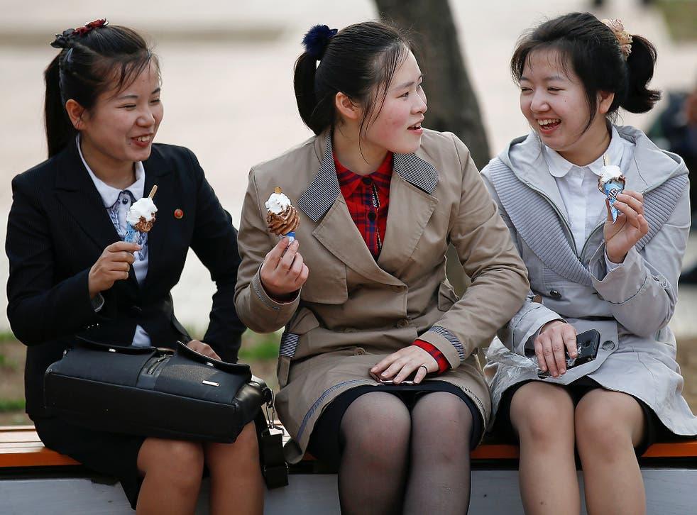 Girls enjoy ice cream in a zoo in Pyongyang, North Korea