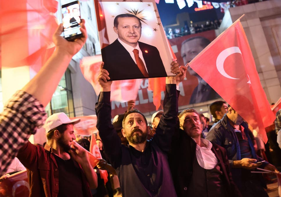 Turkey's President Erdogan claims victory in vote to give him