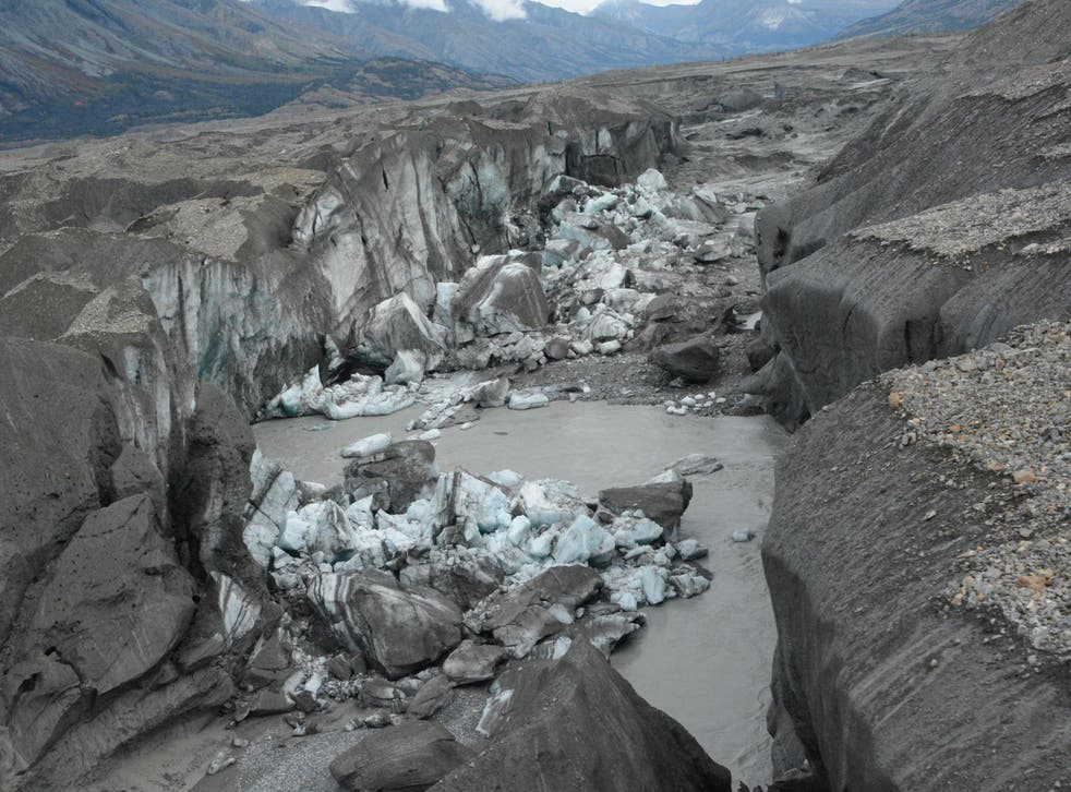 A close-up view of the ice-walled canyon at the end of the Kaskawulsh glacier. This canyon now carries almost all meltwater from the toe of the glacier down the Kaskawulsh Valley, rather than into the Slims River