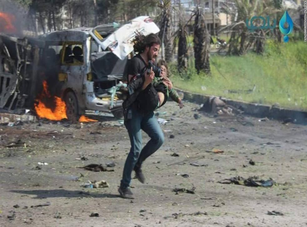 After briefly being knocked unconscious by the blast activist and journalist Abd Alkader Habak put aside his camera to help those wounded