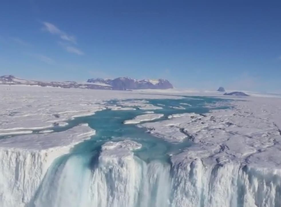 A river of meltwater flows over 120-metre wide waterfall in Antarctica