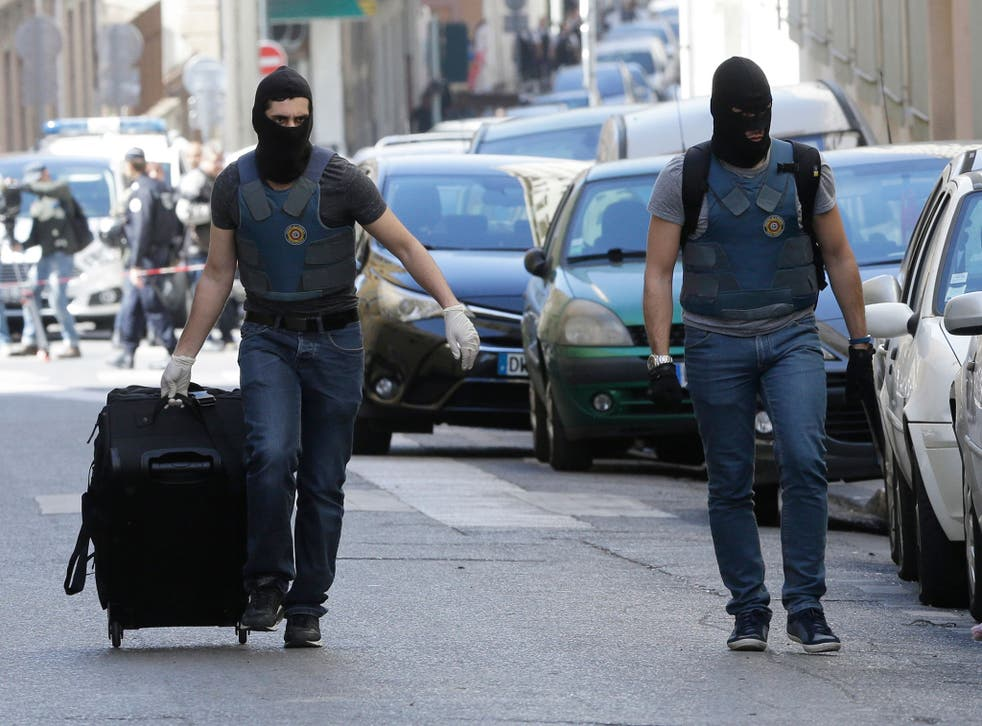 Masked elite police officers during searches in Marseille on 18 April