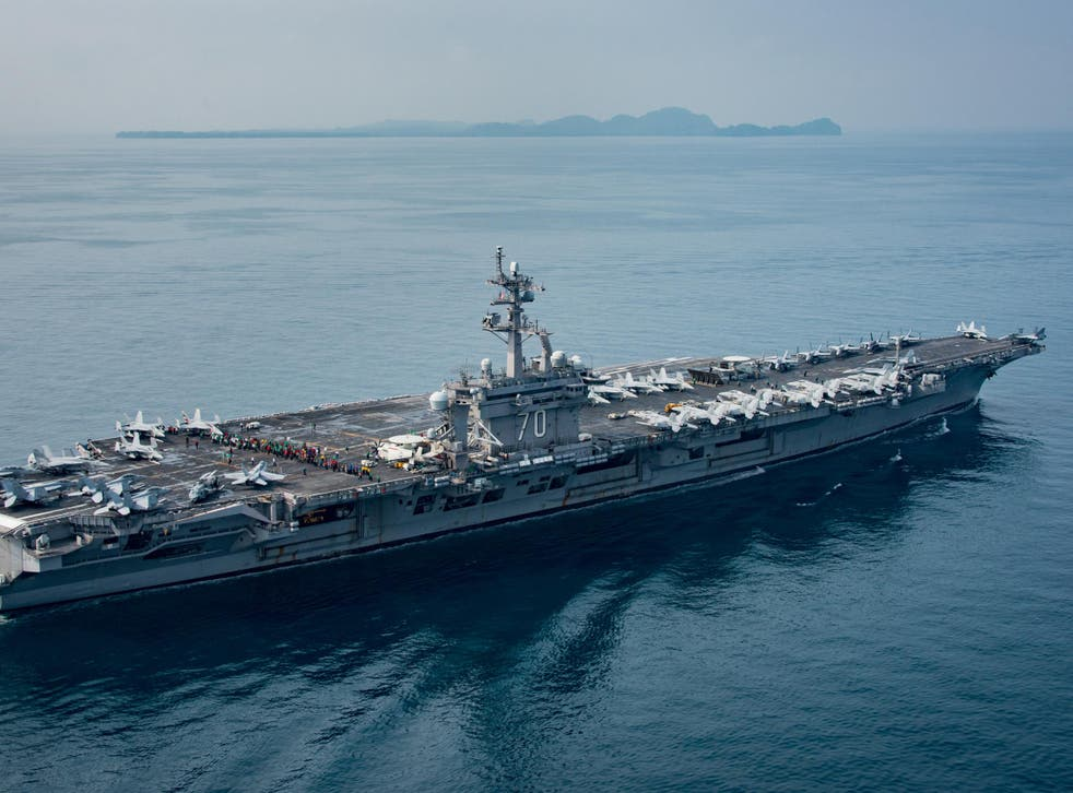 The aircraft carrier USS Carl Vinson (CVN 70) transits the Sunda Strait on 14 April 2017 in Indonesia
