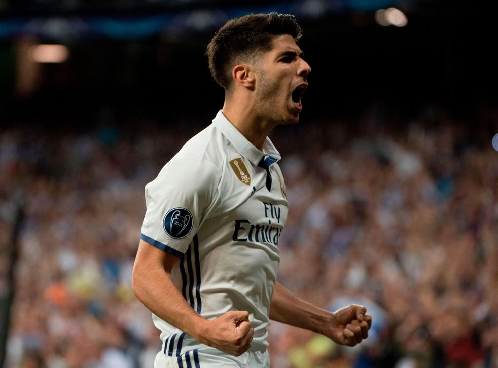 Marco Asensio celebrates his extra-time goal against Bayern