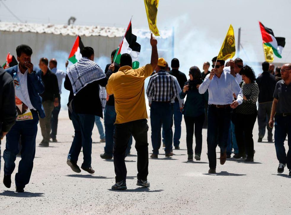 Palestinians protest in solidarity with prisoners on hunger strike in Israeli jails, in front of the Israeli-run Ofer prison in the West Bank village of Betunia on April 20, 2017