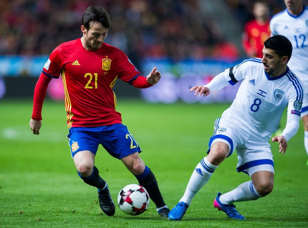 David Silva of Spain duels for the ball with Almog Cohen of Israel during the Fifa 2018 World Cup Qualifier between Spain and Israel at Estadio El Molinon on 24 March, 2017 in Gijon, Spain
