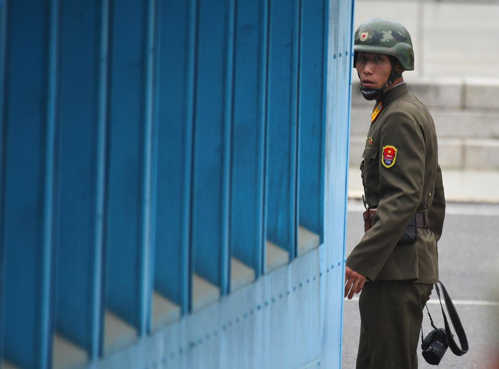 A North Korean patrols one of side of the Demilitarised Zone on the border with South Korea