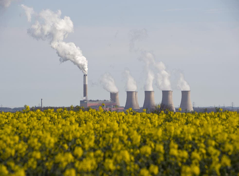 Smoke rises from the cooling towers of Cottam coal-fired power station, near Darlton, Nottinghamshire