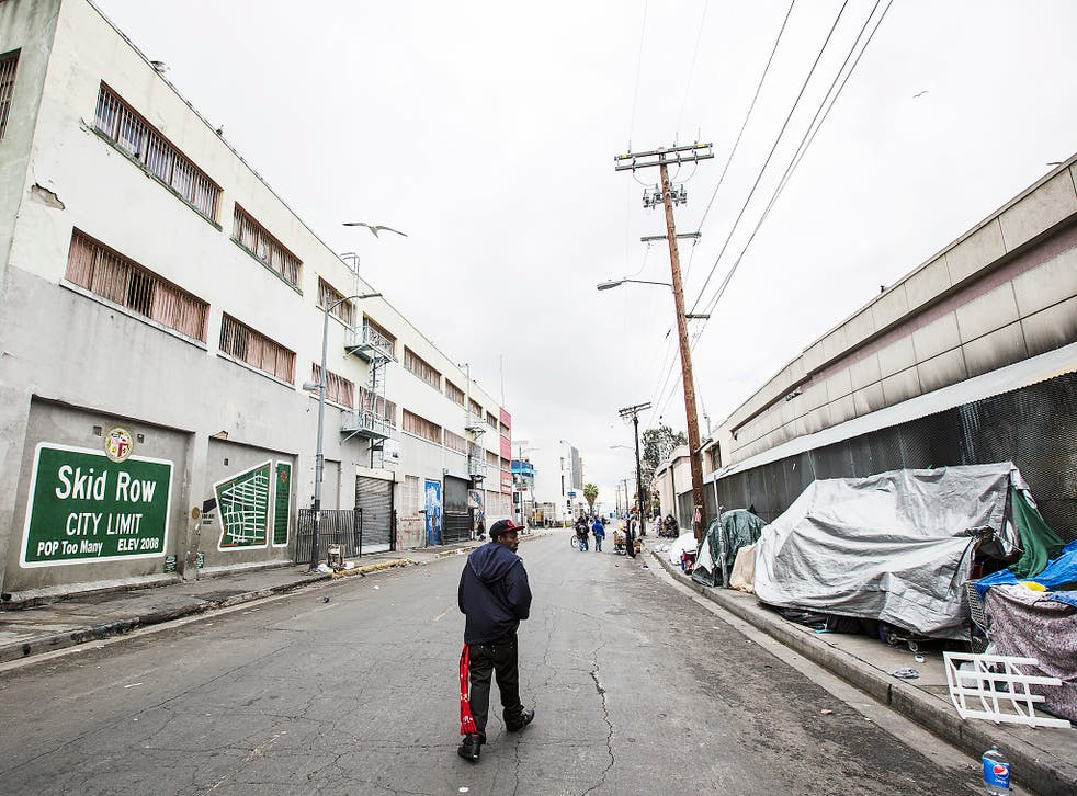 Skid Row in downtown Los Angeles.  Skid Row has LA's largest concentration of homeless people who regularly camp on the sidewalks in tents and cardboard boxes