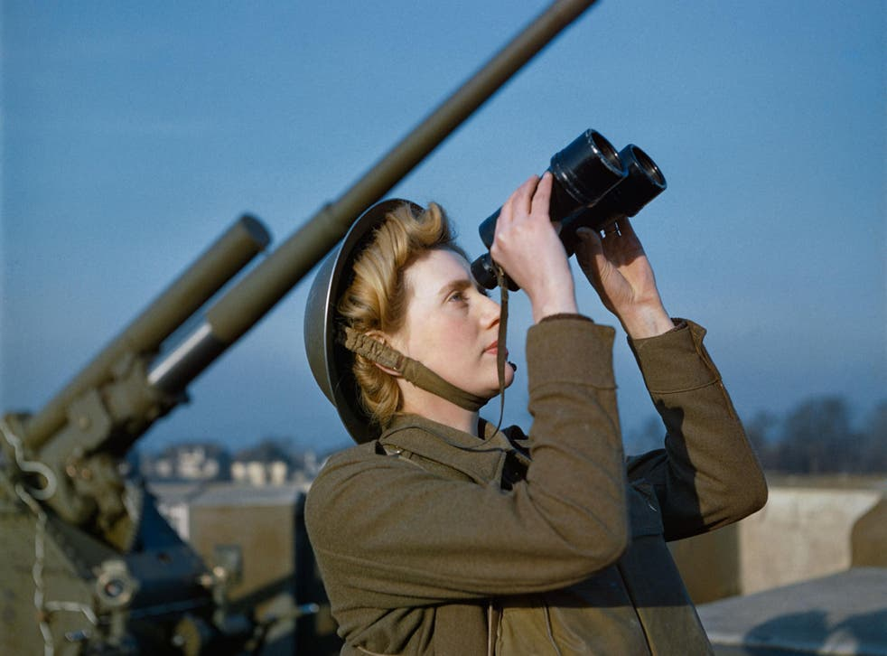 An Auxiliary Territorial Service (ATS) 'spotter' at a 3.7-inch anti-aircraft gun site, December 1942. The photo - taken on colour film - is one of a rare collection which has been released by the Imperial War Museum