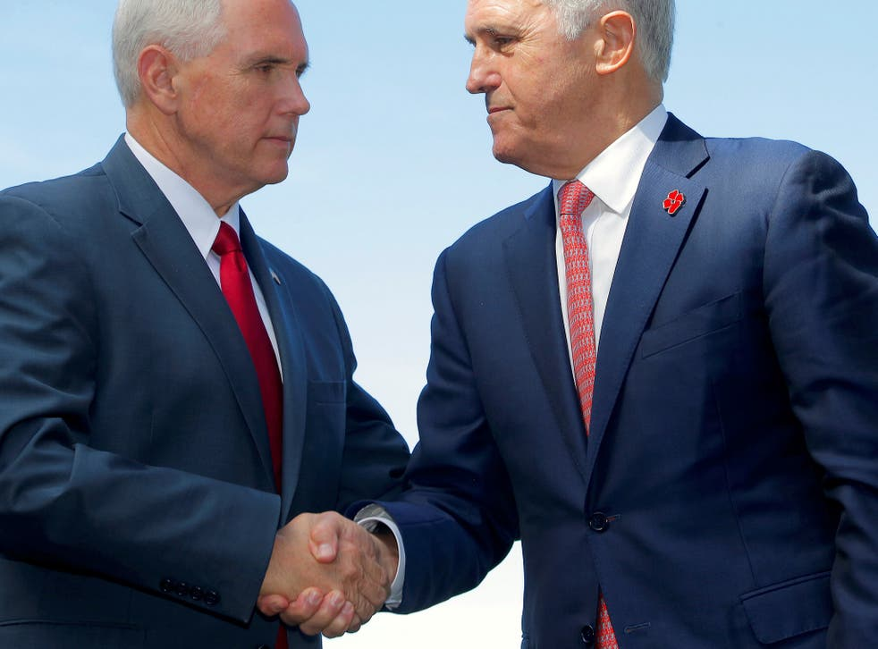 Mike Pence shook hands with Prime Minister Malcolm Turnbull after announcing a US commitment to the refugee resettlement deal