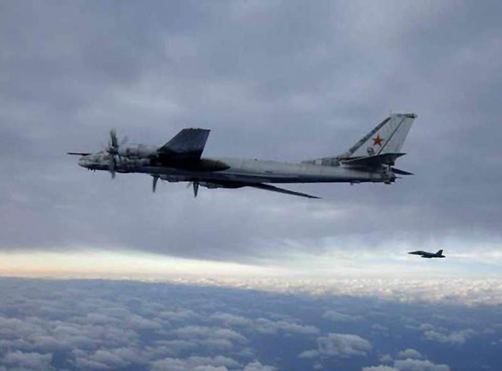 An F/A-18 Hornet escorts a Russian Tu-95 Bear bomber aircraft in February 2008 south of Japan