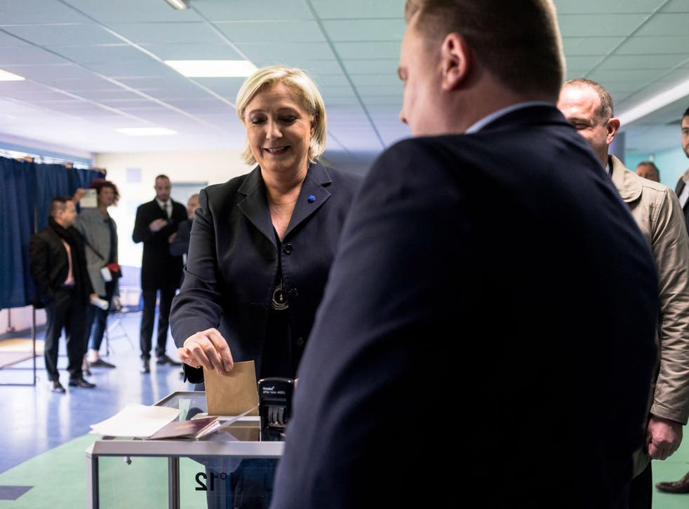 As voting drew to a close in round one of a bitterly contested presidential race, polling suggested Le Pen and centrist Emmanual Macron were in the lead