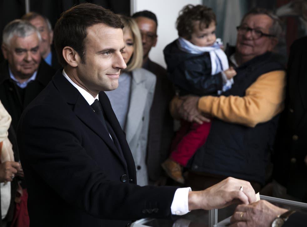 Emmanuel Macron, leader of the En Marche! movement, casts his vote on Sunday