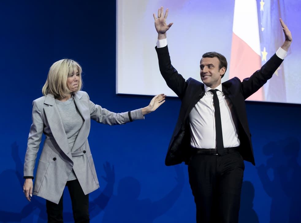 Emmanuel Macron with his wife Brigitte Trogneux addresses activists after the announcement of the French presidential election results