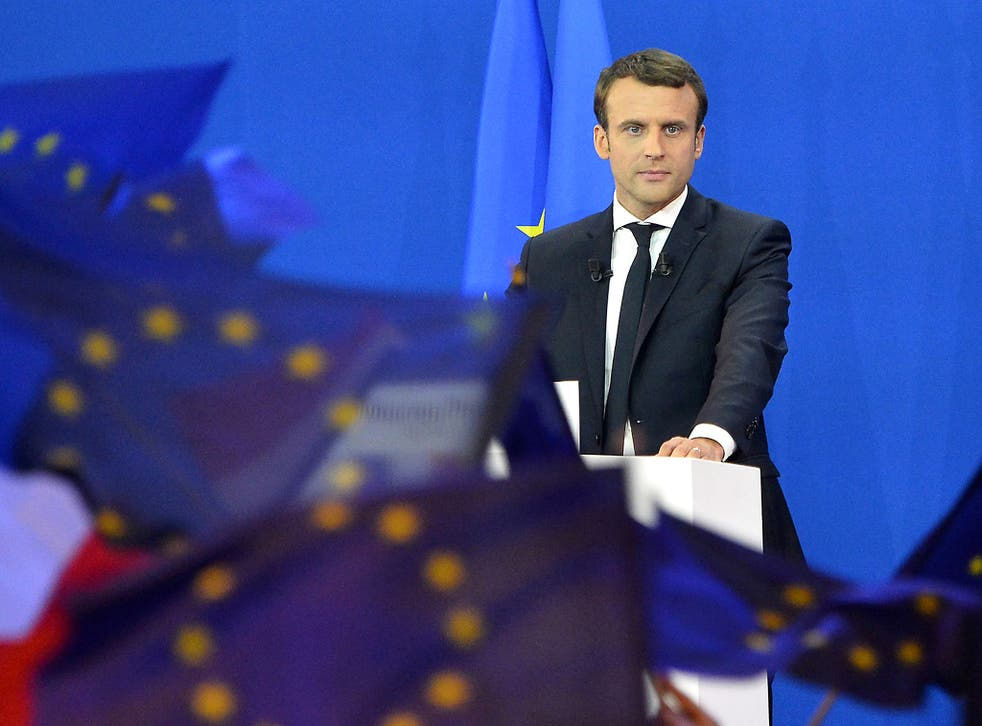 Emmanuel Macron speaks after winning a commanding lead in the first round of the French Presidential Elections