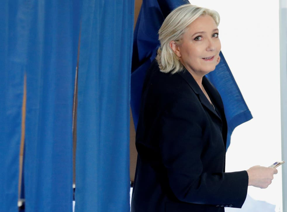 National Front leader Marine Le Pen casts her vote in yesterday's French presidential election at a polling station in Henin-Beaumont