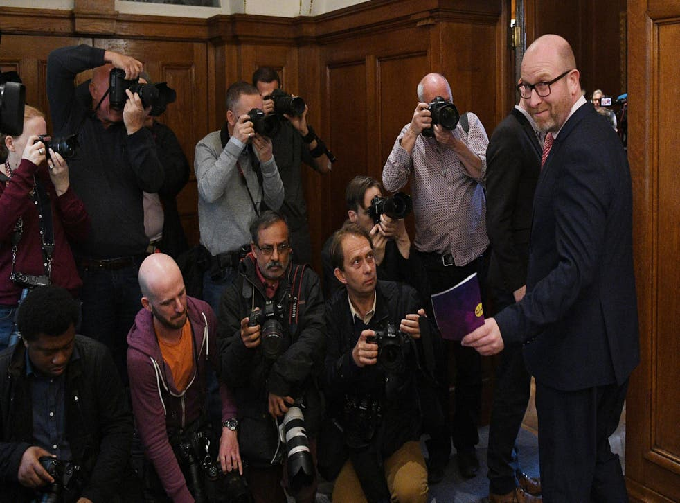 Paul Nuttall (R) arrives to deliver a party's policy announcement at Marriott County Hall London