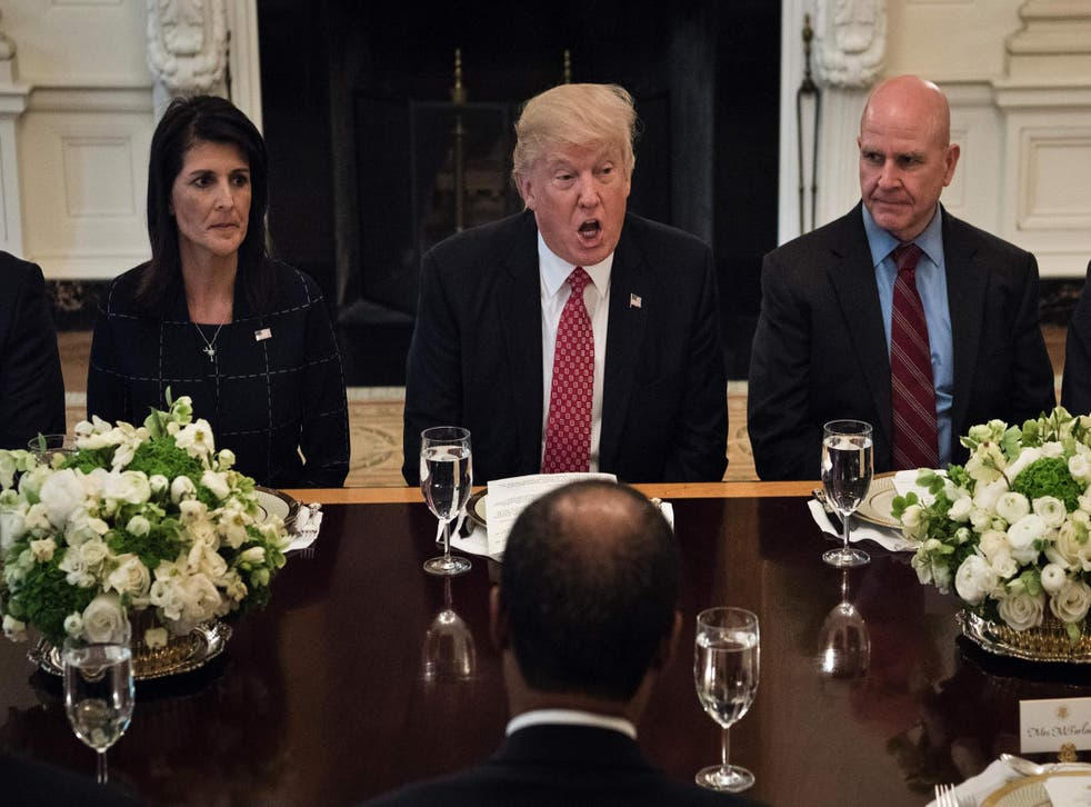 US Ambassador to the UN Nikki Haley and National Security Advisor HR McMaster listen as Donald Trump speaks before a working lunch with UN Security Council member nations at the White House