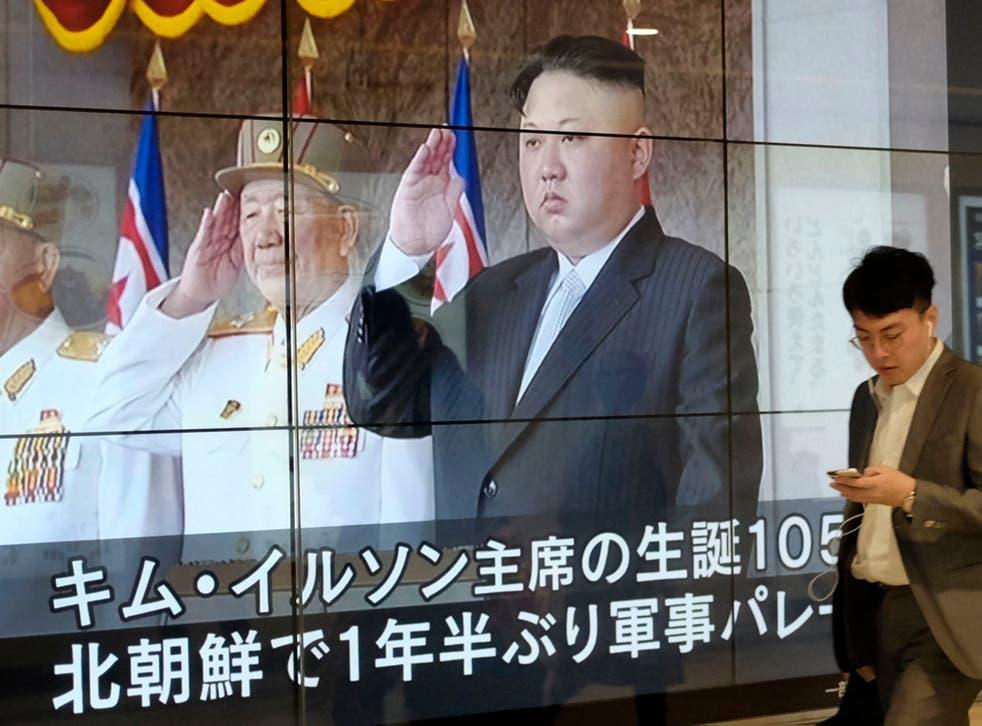 Kim Jong-un seen on state television in full regimental pomp