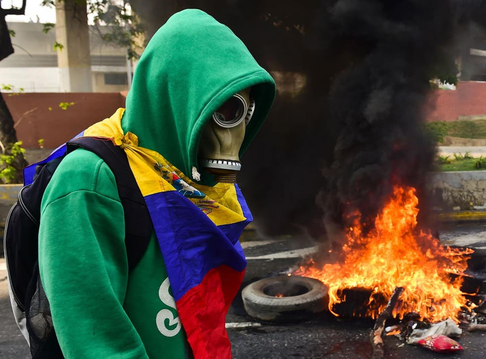 A protester clashes with police in Caracas
