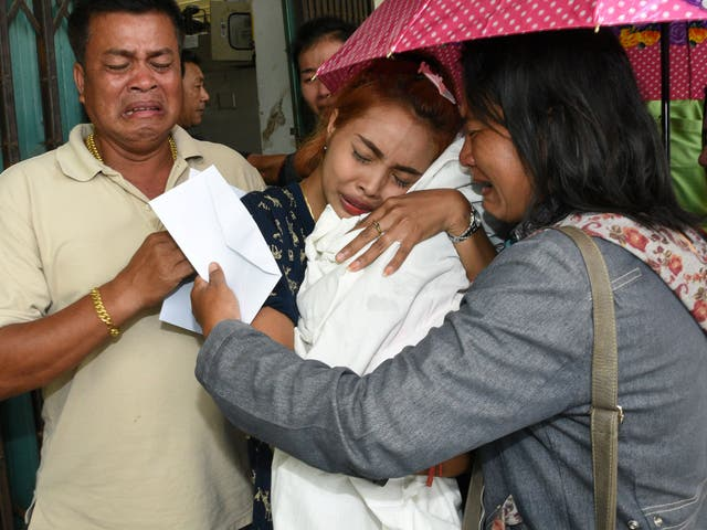 Chiranut Trairat holds up the body of her 11-month-old daughter who was killed by her father in a video shown on Facebook,in Phuket, Thailand, on 25 April